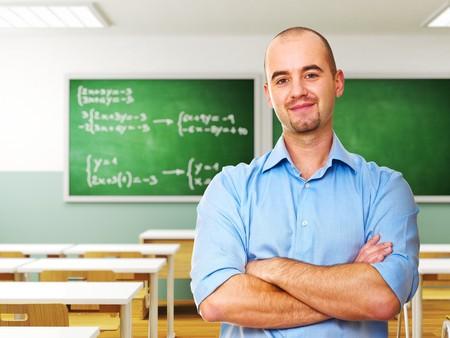 maestra ense�ando: seguro de joven maestro en segundo plano 3d de aula  Foto de archivo