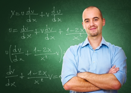 teacher: confident young teacher and classic chalkboard background Stock Photo