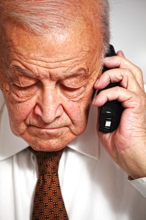 serious senior use phone fine portrait photo