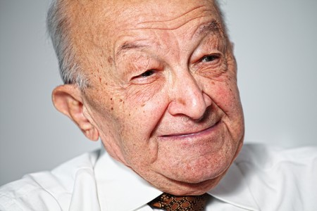 fine portrait of old man smiling photo