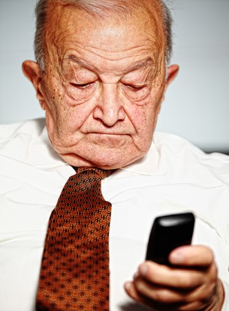 old caucasian man use mobile portrait photo