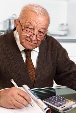 portrait of white senior with calculator Stock Photo - 8094863