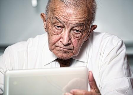 wrinkly: old caucasian man use laptop portrait selective focus image