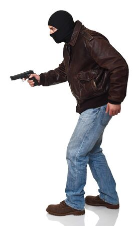 man with gun: thief in action isolated on white background