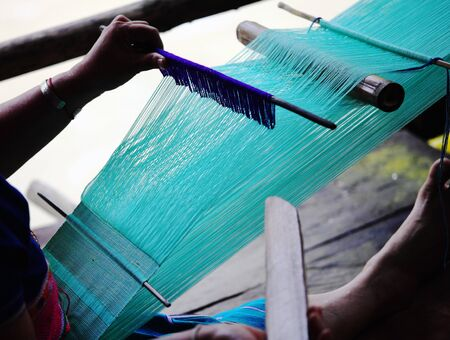 weft: detail of traditional thai loom at work Stock Photo