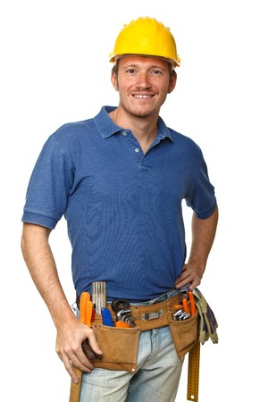 plumber tools: confident handyman portrait isolated on white background