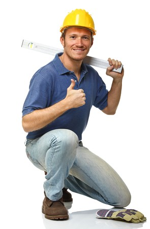 repairmen: crouched handyman with spirit level isolated on white Stock Photo