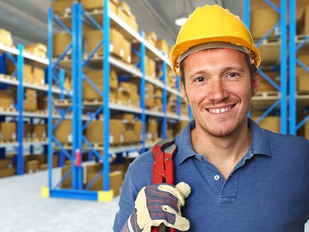 factory worker: fine portrait of labor and 3d warehouse background Stock Photo