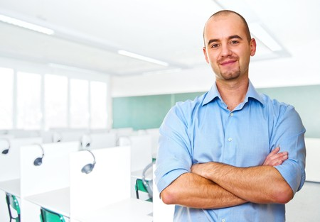 young caucasian teacher and classroom background photo