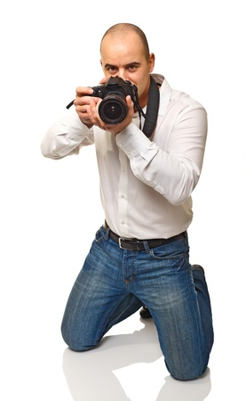 young photographer at work isolated on white background photo