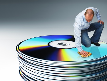 portrait of white man cleaning a pile of cd 3d background Stock Photo - 8396174