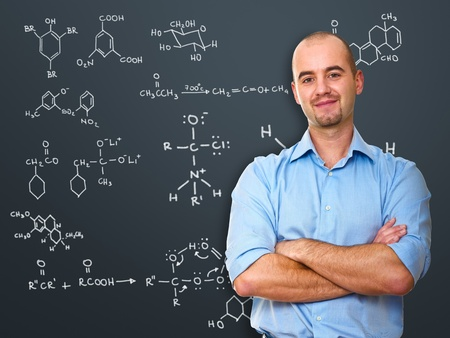 portrait of white teacher infront of blackboard photo