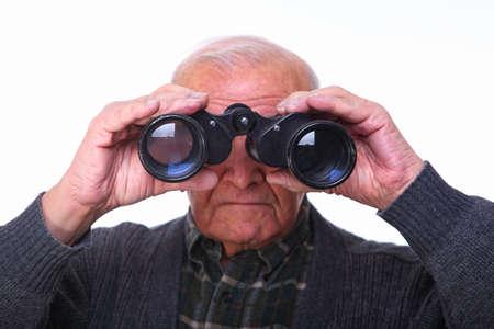 portrait of caucasian senior looking with binoculars Stock Photo - 8442503