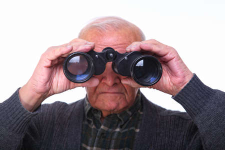 portrait of caucasian senior looking with binoculars Stock Photo - 8442503
