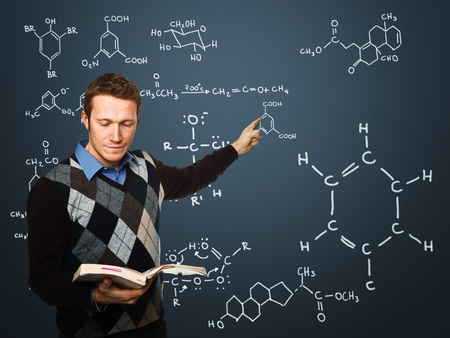 young teacher at work with classic blackboard background Stock Photo - 8491888