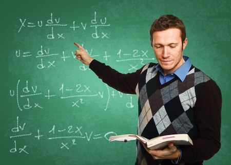portrait of young caucasian teacher with classic green board