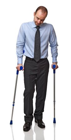 crutch: businessman man walking with crutch  isolated on white