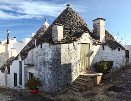 street view of alberobello, famouse trulli town in italy photo