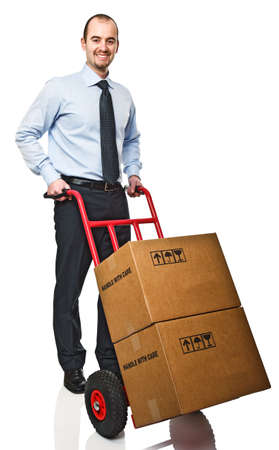 handtruck: smiling businessman with red handtruck and boxes