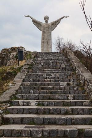 redeeming: picture of huge concrete christ statue in maratea