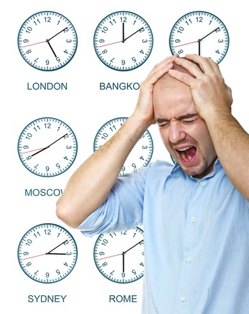 time zone: caucasian man stressed by jet lag with time zone clock background