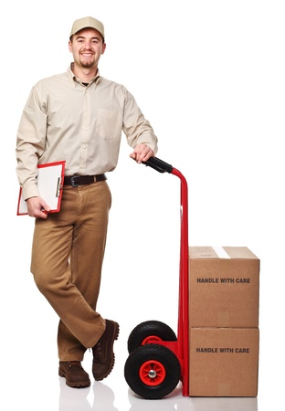 parcel service: smiling delivery man with red handtruck isolated on white
