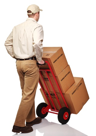 parcel service: delivery man with parcel rear view isolated on white