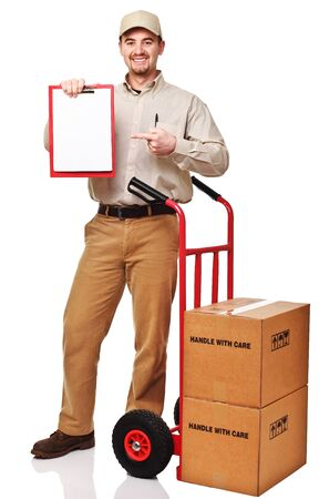 smiling delivery man with red handtruck isolated on white Stock Photo - 8643540