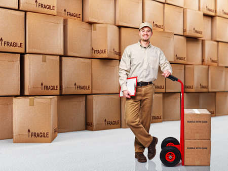 delivery man at work and 3d boxes background Stock Photo - 8643563