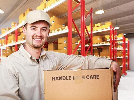 delivering: delivery man with parcel in warehouse 3d background