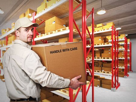 young delivery man at work in a classic warehouse photo