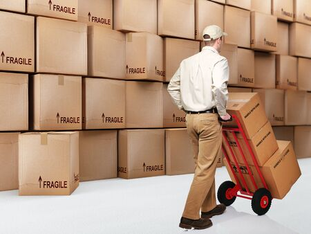 courier man: delivery man at work and 3d boxes background