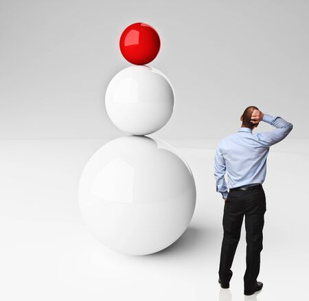 contemplate: 3d balanced balls and thinking man on white