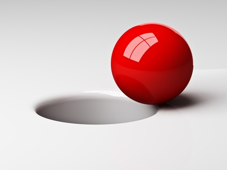 business goal: 3d red ball near to fall in the hole Stock Photo