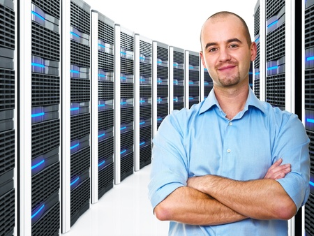 database server: confident young man and datacenter 3d background Stock Photo