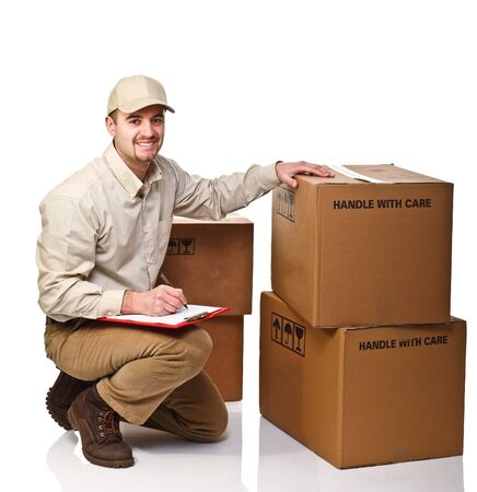 caucasian delivery man at work isolated on white Stock Photo - 8815091