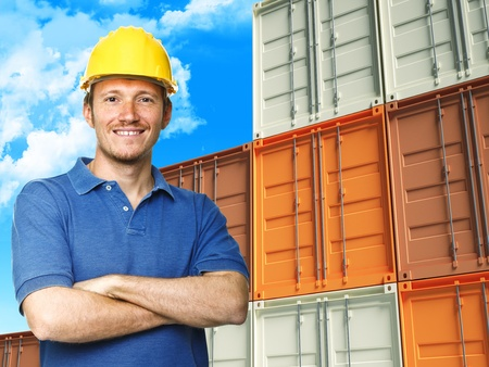 import and export business: handyman with metal container and cloudy sky background Stock Photo