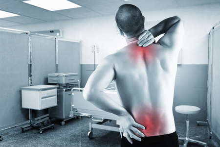 healt: caucasian man with back pain with hospital background