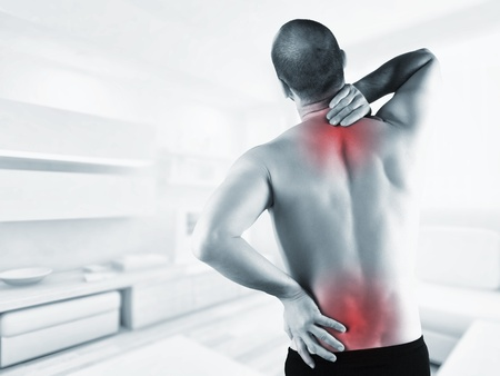 men   back: man at home with back pain in red zone
