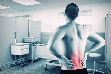 caucasian man with back pain with hospital background photo