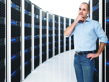 caucasian businessman and  datacenter with lots of server photo