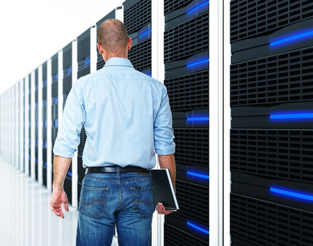 datacentre: caucasian man and  datacentre with lots of server