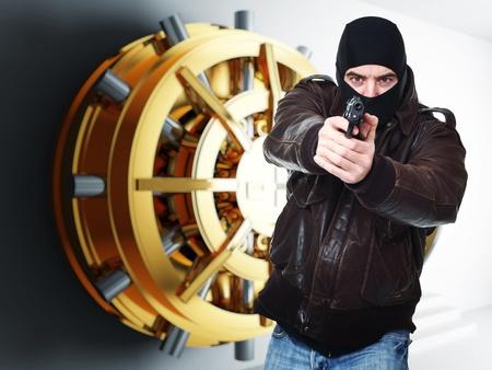 theft: armed thief and bank golden vault door 3d  Stock Photo