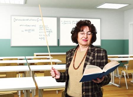 portrait of senior woman teacher at school