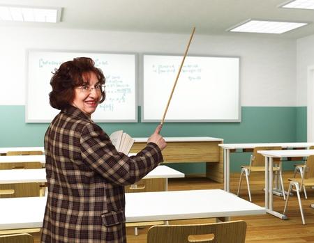 educator: smiling senior teacher in classroom take a lesson