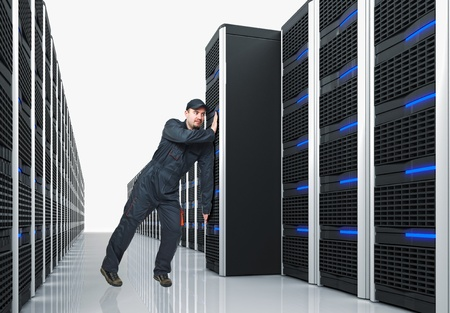 young manual worker move huge 3d server photo