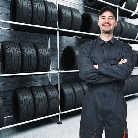 smiling mechanic and 3d tires garage background Stock Photo - 8943873