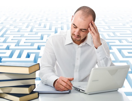 caucasian young man study at computer with 3d maze abstract background photo