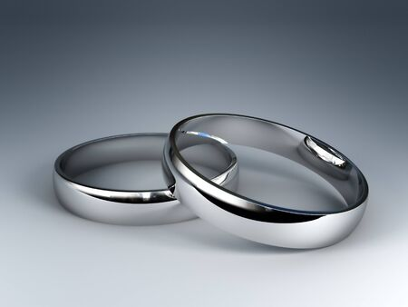 nuptials: fine 3d image of classic silver wedding rings Stock Photo