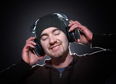 portrait of young caucasian man with cap and headphone photo